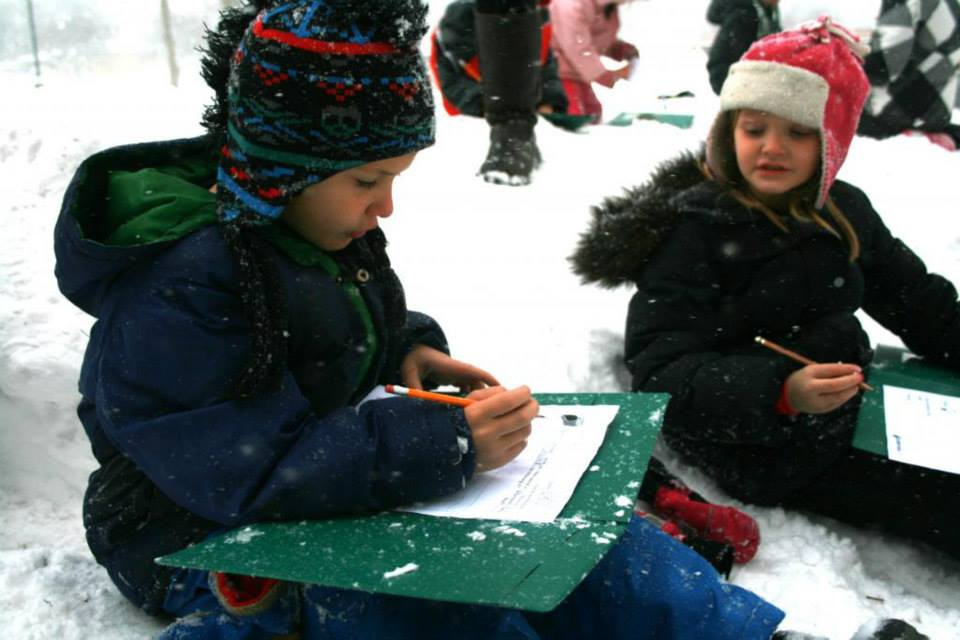 children learning in the snow