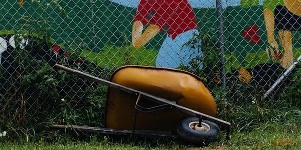 fence with wheelbarrow