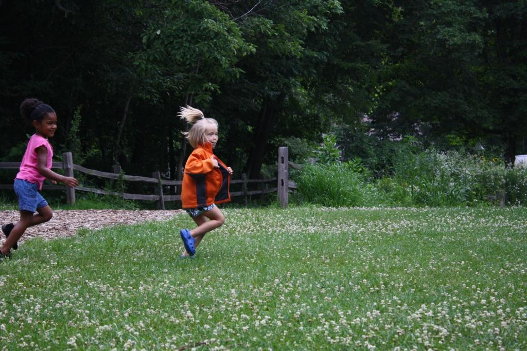 kids running clover field