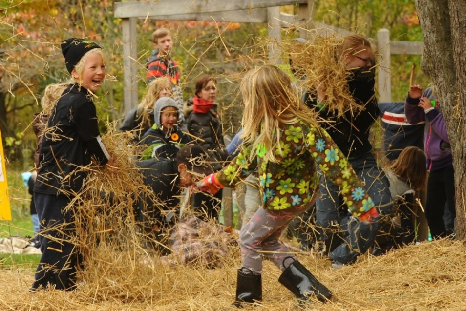 kids playing in hay fall