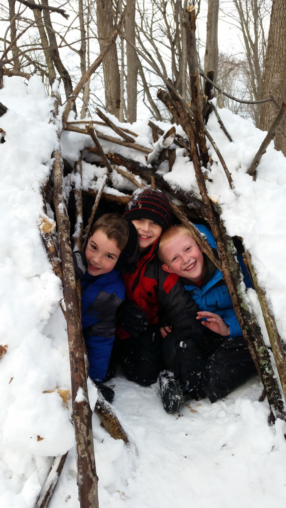 children playing in a snow fort